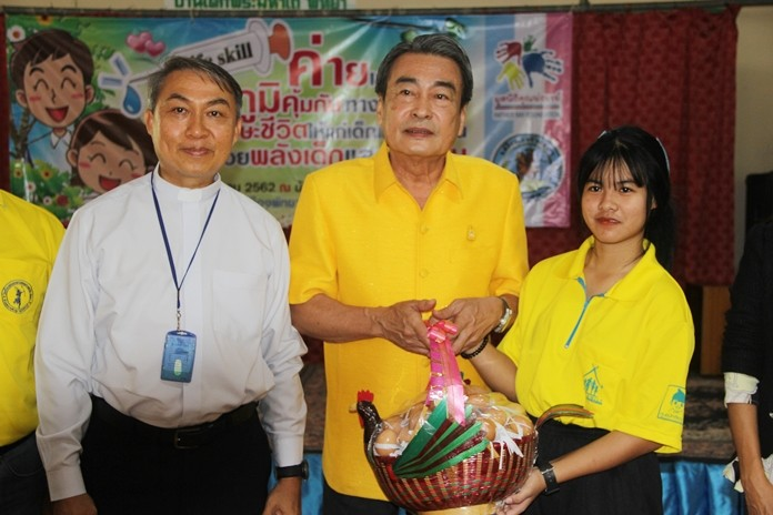 Deputy Mayor Ronakit Ekasingh opened the camp and in return received a basket of eggs from Father Peter.