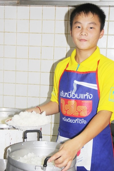 Future chef making sure there is enough rice for everyone.