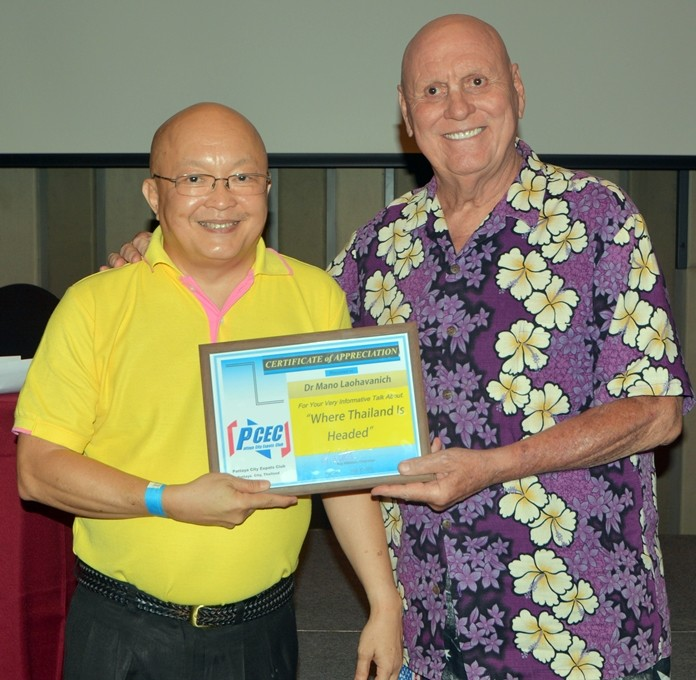 Dr. Laohavanich accepts the PCEC's Certificate of Appreciation for his excellent talk about Thailand's past and his expectations for the future.