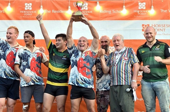 Southerners Black players celebrate on the podium after winning the Cup final at the Chris Kays Memorial Rugby Tournament at Horseshoe Point in Pattaya, Sunday, May 5. (Photo/Robert Lincoln)
