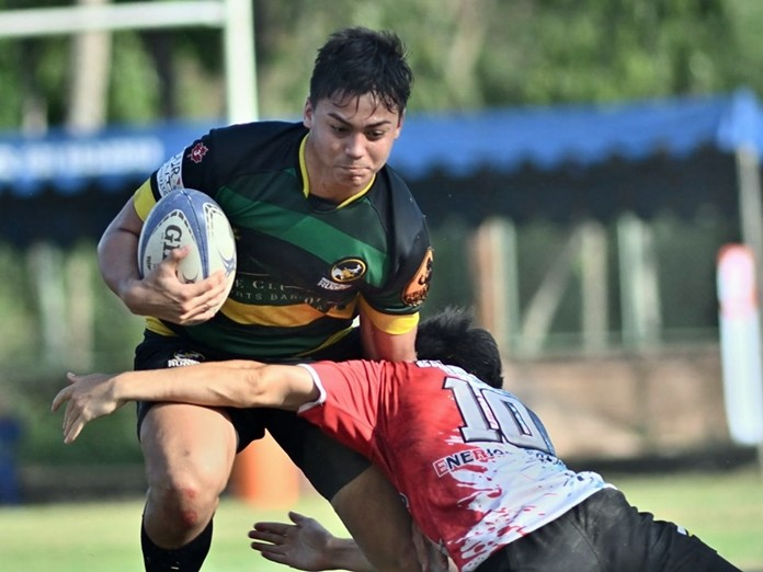 A French Asian Barbarian put a hard tackle on Southerners Black in the Cup final. (Photo/Robert Lincoln)