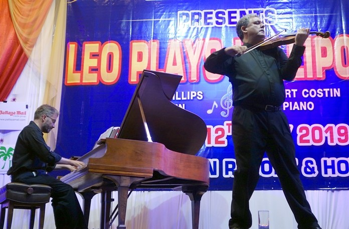 Leo Phillips plays violin and Robert Costin piano at the fund-raising show held at Diana Garden Resort on May 13.
