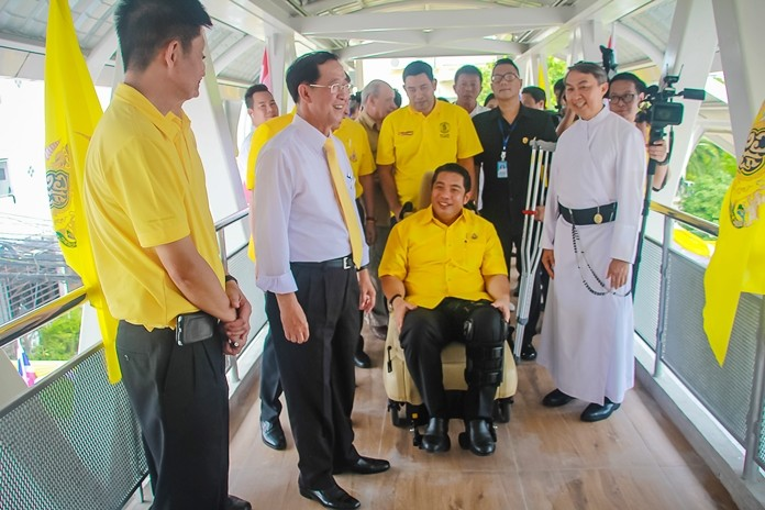Mayor Sonthaya Kunplome, who due to a recent lower limb accident was sitting in a wheelchair, gets a firsthand look at the convenience the bridge affords people with disabilities.