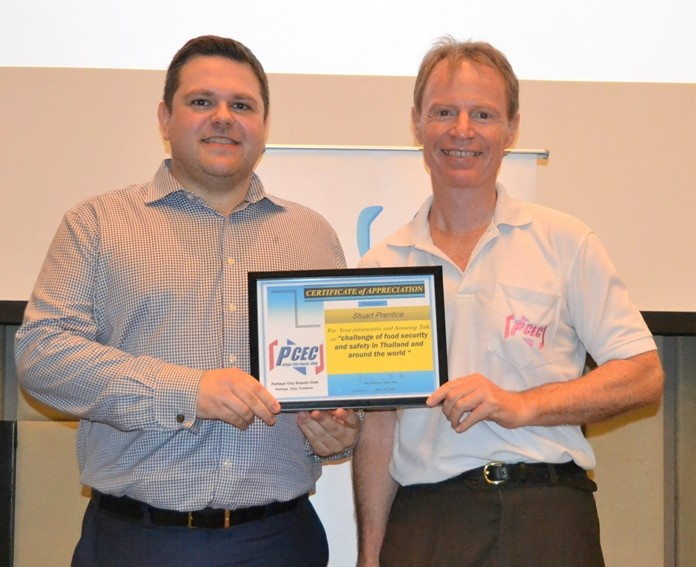 MC Ren Lexander presents Stuart Prentice with the PCEC's Certificate of Appreciation for his informative and interesting presentation about food security and safety in today's world.