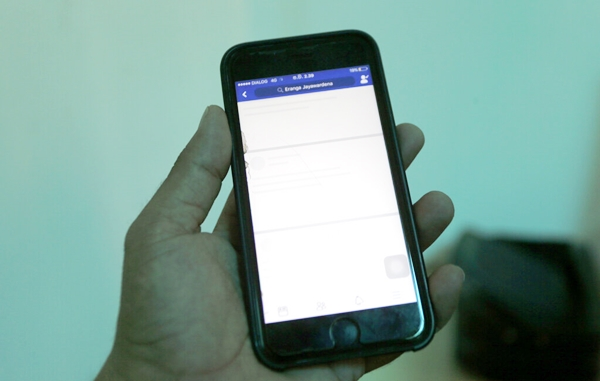 A blocked Facebook window is seen on a smart phone screen in Colombo, Sri Lanka. (AP Photo/Eranga Jayawardena)