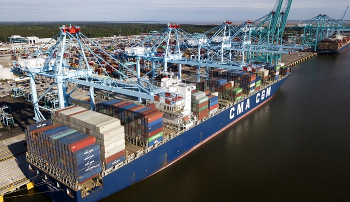 In this May 9, 2019, file photo a container ship is unloaded at the Virginia International Gateway terminal in Norfolk, Virginia. (AP Photo/Steve Helber)