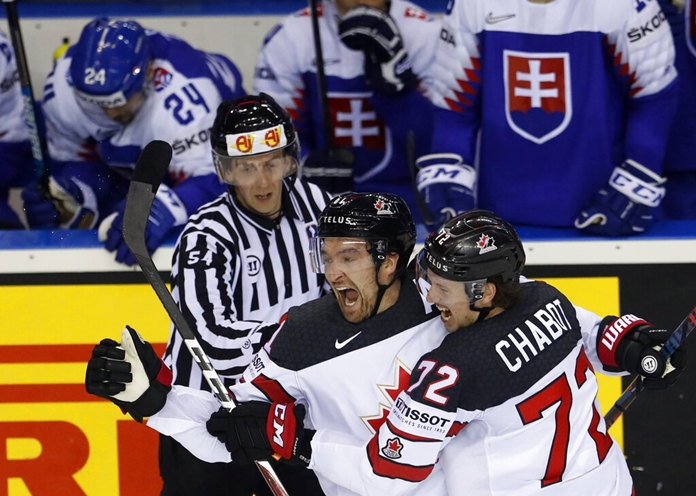Canada's Mark Stone, left, celebrates with Canada's Thomas Chabot, right, after scoring his side's sixth goal during the Ice Hockey World Championships Group A match between Slovakia and Canada at the Steel Arena in Kosice, Slovakia, Monday, May 13, 2019. (AP Photo/Petr David Josek)