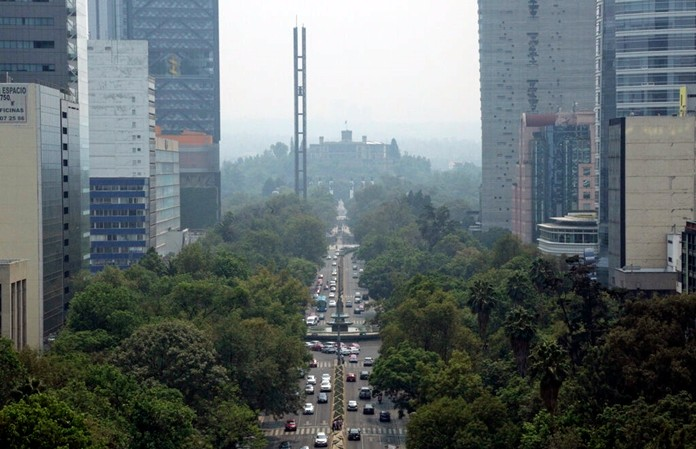 Smoke and pollution hangs over in Mexico City's iconic Reforma Avenue and Chapultepec Castle, Tuesday, May 14, 2019. (AP Photo/Gerardo Carrillo)