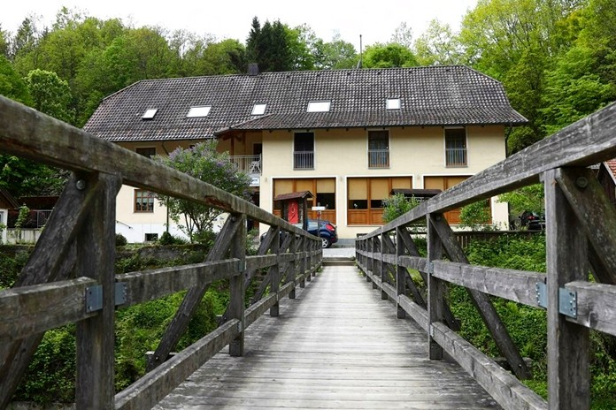 A guesthouse is pictured at the river 'Ilz' in Passau, Germany, Monday, May 13, 2019. (AP Photo/Matthias Schrader)