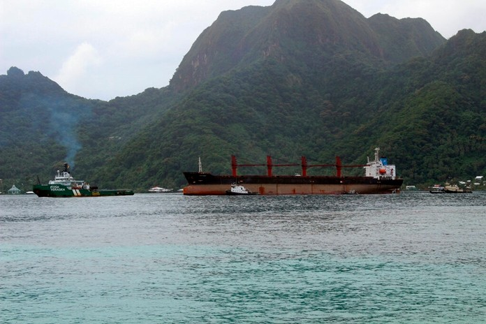 The North Korean cargo ship, Wise Honest, middle, was towed into the Port of Pago Pago in the late morning on Saturday, May 11, 2019, in American Samoa. (AP Photo/Fili Sagapolutele)