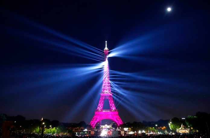 A light show illuminates the Eiffel Tower for its 130 year anniversary, in Paris, Wednesday, May 15, 2019. (AP Photo/Christophe Ena)