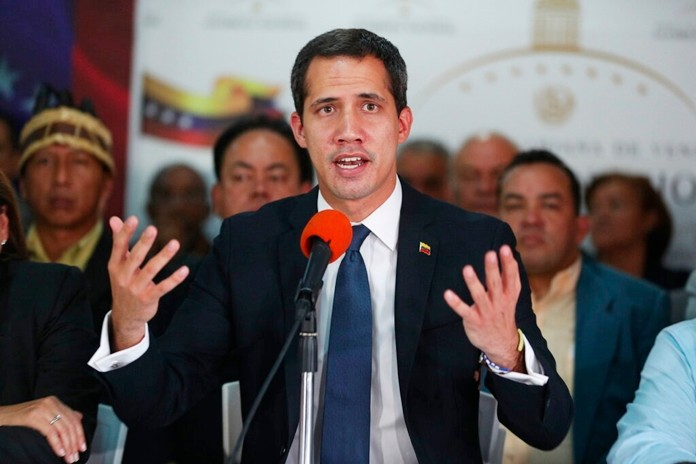 Venezuela's opposition leader Juan Guaido speaks during a press conference at his campaign office in Caracas, Venezuela, Tuesday, May 14, 2019. (AP Photo/Martin Mejia)
