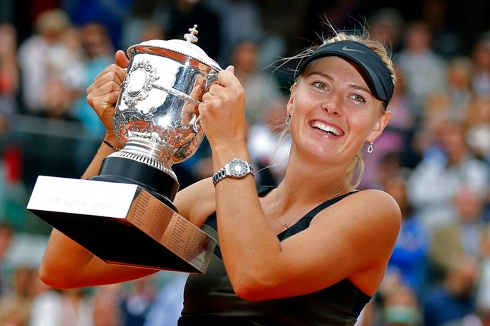 In this Saturday June 9, 2012 file photo, Maria Sharapova of Russia holds the trophy after winning the women's final match at the French Open tennis tournament at Roland Garros stadium in Paris. (AP Photo/Michel Euler)