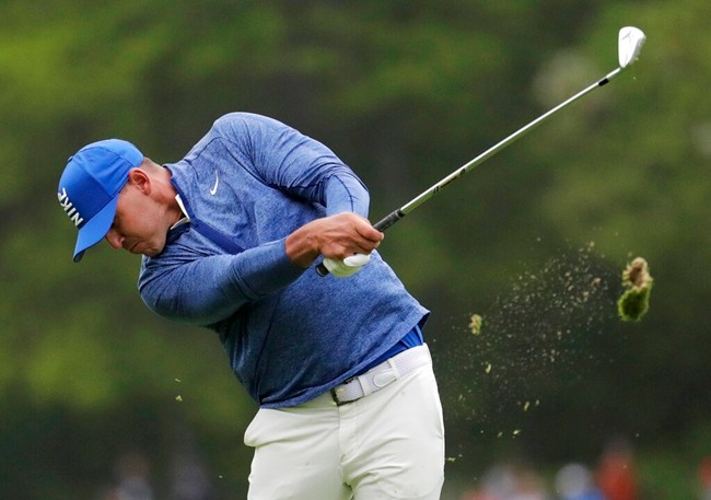 Brooks Koepka hits off the fourth fairway during the second round of the PGA Championship golf tournament, Friday, May 17, 2019, at Bethpage Black in Farmingdale, N.Y. (AP Photo/Julio Cortez)