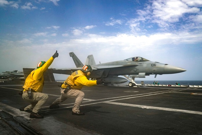 In this Thursday, May 16, 2019 photo released by the U.S. Navy, an F-18 Super Hornet flies from the deck of the USS Abraham Lincoln aircraft carrier in the Arabian Sea. (Mass Communication Specialist 3rd Class Jeff Sherman, U.S. Navy via AP)