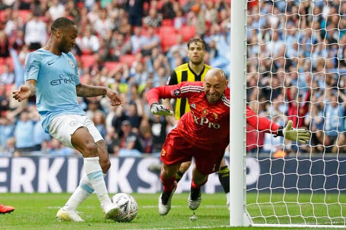 Manchester City's Raheem Sterling, left, scores his side's sixth goal past Watford's goalkeeper Heurelho Gomes during the English FA Cup Final soccer match between Manchester City and Watford at Wembley stadium in London, Saturday, May 18, 2019. (AP Photo/Tim Ireland)