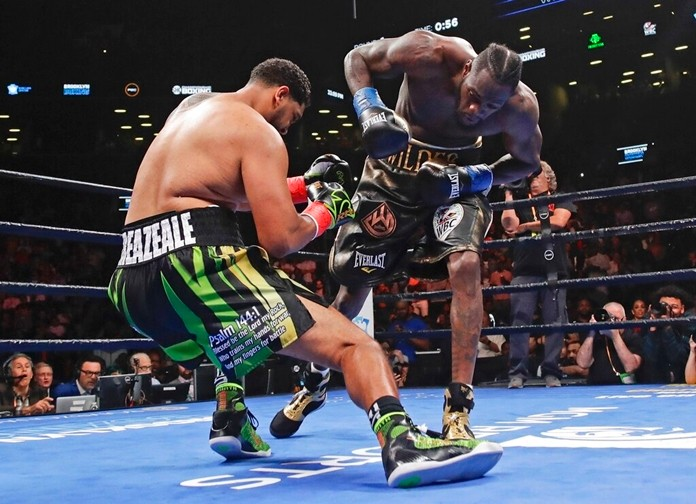 Deontay Wilder, right, knocks down Dominic Breazeale during the first round of their WBC heavyweight championship boxing match Saturday, May 18, 2019, in New York. Wilder stopped Breazeale in the first round. (AP Photo/Frank Franklin II)