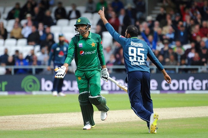 Pakistan's Babar Azam, left, is run out by England's Adil Rashid, right, during the Fifth One Day International cricket match between England and Pakistan at Emerald Headingley in Leeds, England, Sunday, May 19, 2019. (AP Photo/Rui Vieira)
