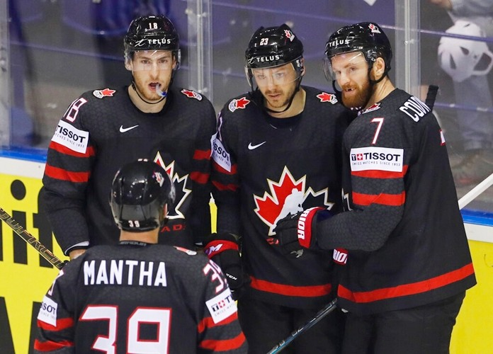 Canada's Sam Reinhart, 2nd right, celebrates with teammates after scoring his side's fourth goal during the Ice Hockey World Championships group A match between Canada and Denmark at the Steel Arena in Kosice, Slovakia, Monday, May 20, 2019. (AP Photo/Petr David Josek)