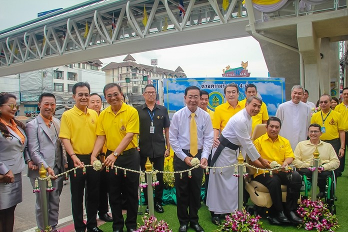 Transport Minister Arkhom Termpittayapaisith cuts the ribbon to officially open the new wheelchair-accessible bridge over Sukhumvit Road. Also on hand to perform the ceremony are Kritchthep Simalee - Director General of Department of Rural Roads, Pattaya Mayor Sonthaya Kunplome, Deputy Mayors Ronakit Ekasingh and Manote Nongyai, Rev. Peter Pattarapong Srivorakul - President of Father Ray Foundation, and Pol. Col. Korn Somkanay – Deputy Superintendent of Pattaya Police Station.