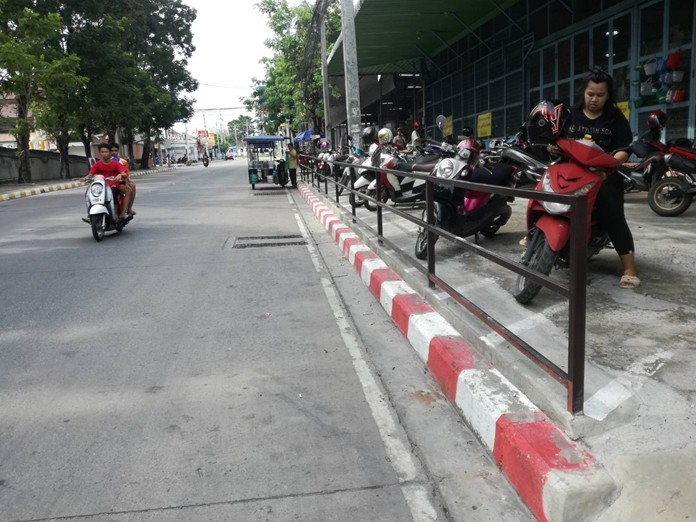 City workers have painted no-parking markers on curbs behind Central Marina shopping mall.