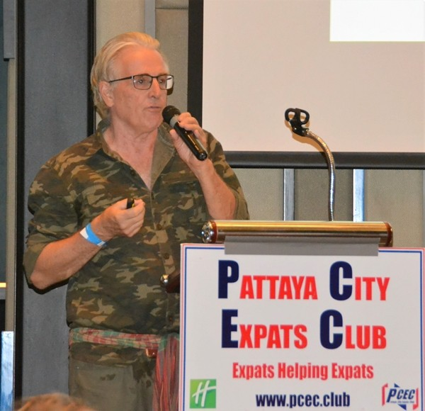 Dr. Stewart McFarlane tells the PCEC audience of his background before describing some of the unusual things one sees in Thailand and gives his explanation on why they exist.