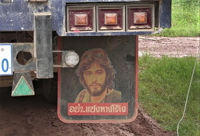 When introducing this slide of a man's face often seen on the mud flaps or elsewhere on trucks in Thailand, Dr. Stewart McFarlane asked his PCEC audience if they knew who the person was or why it was there.