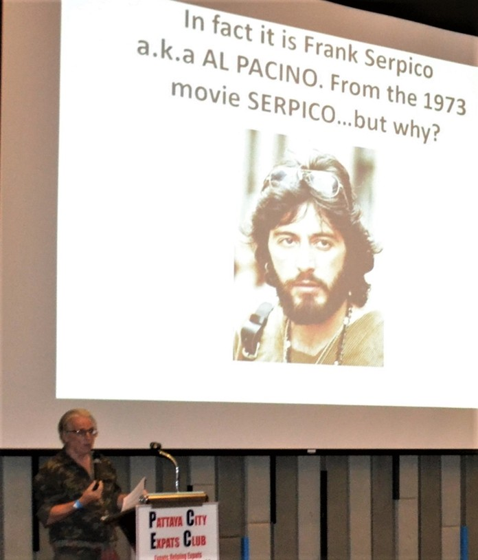 Following the slide depicting a bearded man's face on a Thai truck's mud flap, Dr. Stewart McFarlane introduced another slide identifying the face as that of Al Pacino from the 70's movie Serpico. He then went on to enlighten his audience on why Thai truckers would include the likeness of Serpico on their trucks.
