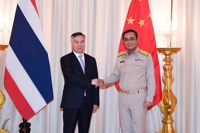 Prime Minister Gen. Prayut Chan-o-cha (right) greets Chinese government representative Li Xi at Government House in Bangkok.