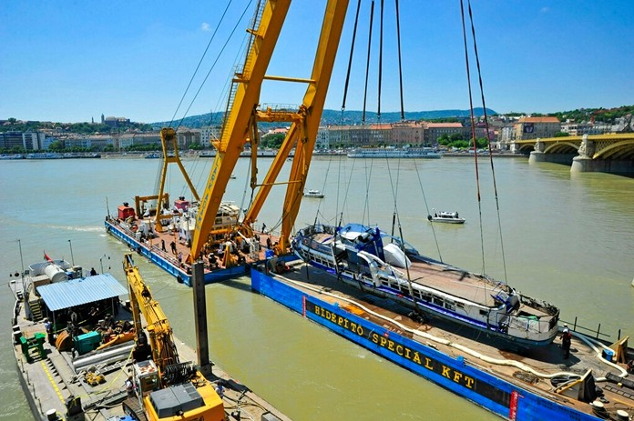 A crane lifts the wreckage of the sightseeing boat out of the Danube river at Margaret Bridge in Budapest, Hungary, Tuesday, June 11, 2019. (Peter Lakatos/MTI via AP)