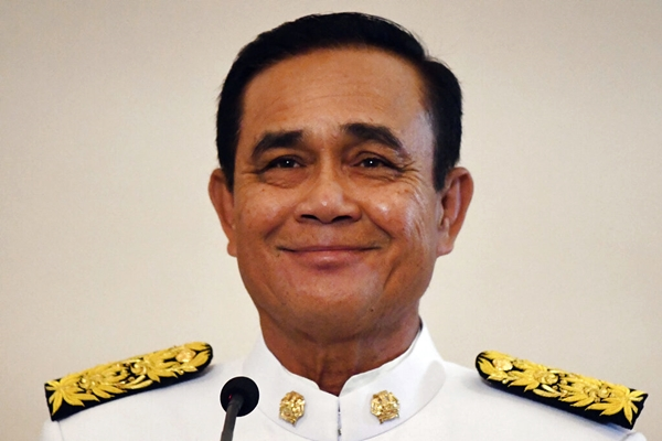 Gen.Prayuth Chan-ocha smiles after the royal endorsement ceremony to proclaim his as the nation's prime minister at the Government House in Bangkok, Tuesday, June 11, 2019. (Lillian Suwanrumpha/Pool Photo via AP)