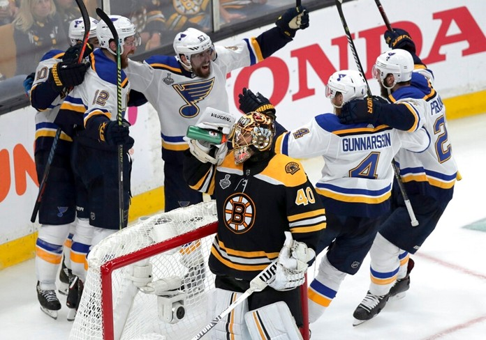 St. Louis Blues' Zach Sanford (12) celebrates his goal with teammates behind Boston Bruins goaltender Tuukka Rask (40) during the third period in Game 7 of the NHL hockey Stanley Cup Final, Wednesday, June 12, 2019, in Boston. (AP Photo/Charles Krupa)