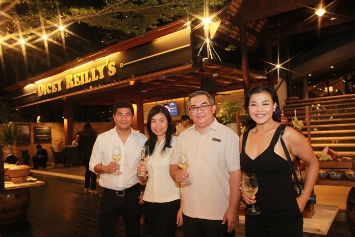Terapan Chuaprasert (2nd right), Executive Assistant Manager at Avani Pattaya Resort & Spa, with Siam Winery representative Koolapatporn Intarasing (right) and important staff open the wine dinner at Dicey Reilly's.