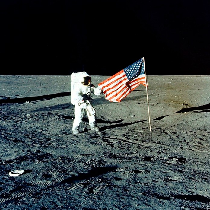 "In this November 1969 photo provided by NASA, Apollo 12 mission Commander Charles P. ""Pete"" Conrad stands on the moon's surface. He was the third man to walk on the moon. On Tuesday, May 14, 2019, NASA's chief says the Trump administration's proposed $1.6 billion budget boost is a ""good start"" for putting astronauts back on the moon. (AP Photo/NASA)"