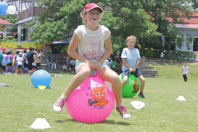 Students bounce their way through a recent fun day.