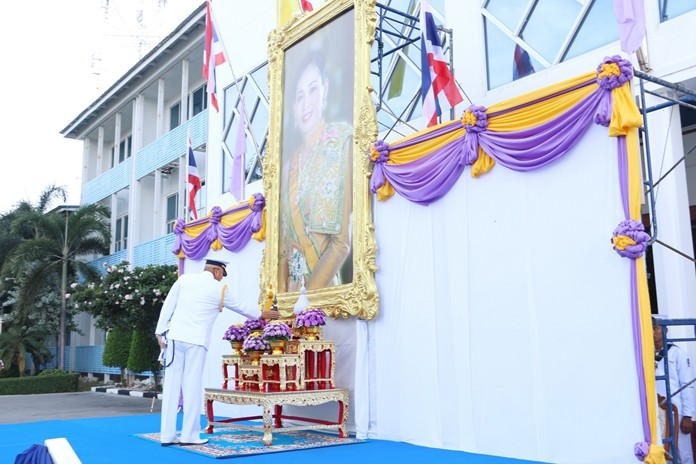 Adm. Noppadol Supakorn, commander-in-chief of the Royal Thai Fleet, pays his respects to our new Queen.