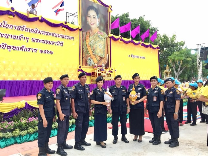Police volunteers pay their respects to HM the Queen Suthida.