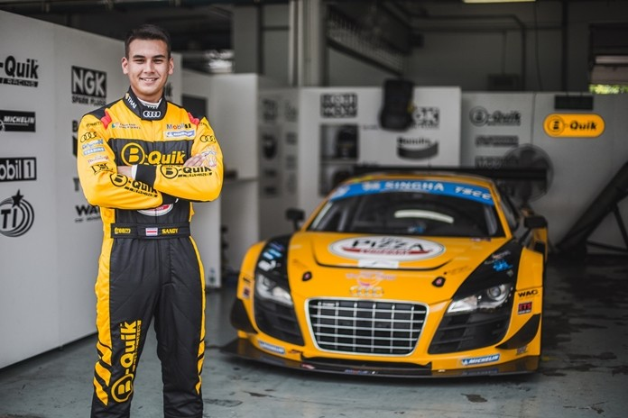 Thai racing driver Sandy Stuvik poses with the B-Quik Racing Audi R8 GT3 Ultra.