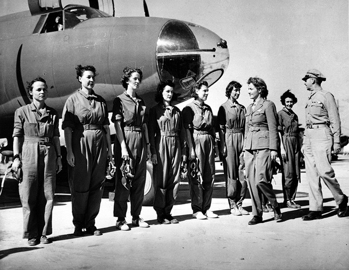 In this Sept. 22, 1942 file photo, aviator Nancy Harkness Love, director of the Women's Auxiliary Ferry Squadron (WAFS), and Col. Robert H. Baker, commanding officer, inspect the first contingent of women pilots in the WAFS at the New Castle Army Air Base, Del. Women didn't get much of a mention in the 75th anniversary commemorations of D-Day that focused largely on the fighting exploits of men, yet without women Adolf Hitler wouldn't have been defeated. (AP Photo, File)