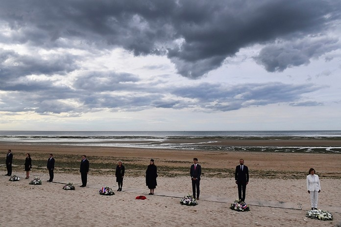 From the right, U.S House Speaker Nancy Pelosi, French Prime Minister Edouard Philippe, Canadian Prime Minister Justin Trudeau, Britain's Defence Secretary Penny Mordaunt and Dutch Defence Minister Ank Bijleveld and other officials attend an international ceremony on Juno Beach in Courseulles-sur-Mer, Normandy, Thursday, June 6, 2019, as part of D-Day commemorations marking the 75th anniversary of the World War II Allied landings in Normandy. (Fred Tanneau, Pool via AP)