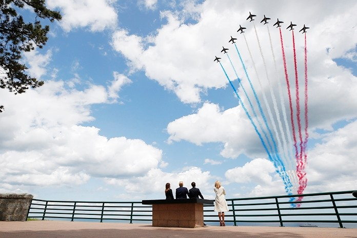 (L to R) First lady Melania Trump, President Donald Trump, French President Emmanuel Macron and Brigitte Macron, watch a flyover during a ceremony to commemorate the 75th anniversary of D-Day at the American Normandy cemetery, Thursday, June 6, 2019, in Colleville-sur-Mer, Normandy, France. (AP Photo/Alex Brandon)