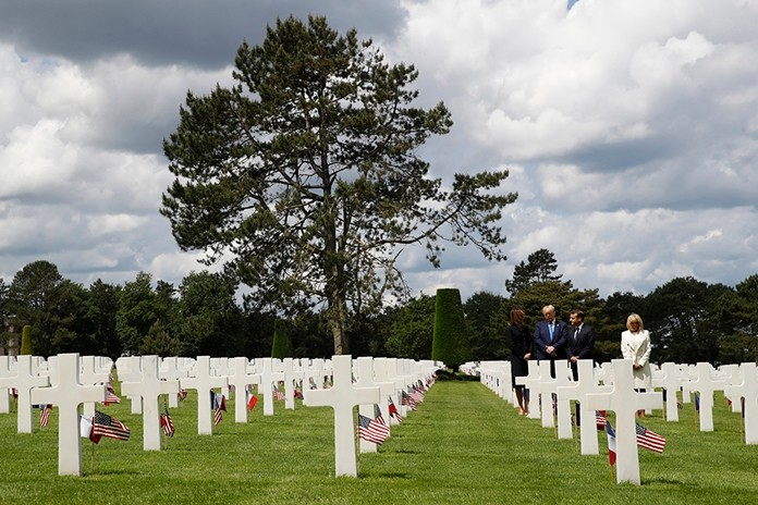 (L to R) First lady Melania Trump, President Donald Trump, French President Emmanuel Macron and Brigitte Macron, walk through The Normandy American Cemetery, following a ceremony to commemorate the 75th anniversary of D-Day, Thursday, June 6, 2019, in Colleville-sur-Mer, Normandy, France. (AP Photo/Alex Brandon)