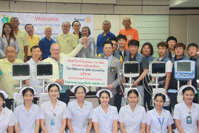 Past District Governor Premprecha Dibbayawan, chair of Rotary District 3340 Foundation Committee, Steve Devereux, President of the Rotary Club of Pattaya and Kim Jinbum, President of the Rotary Club of Pocheon present the equipment to hospital deputy chief Dr. Chanchai Limthongcharoen.