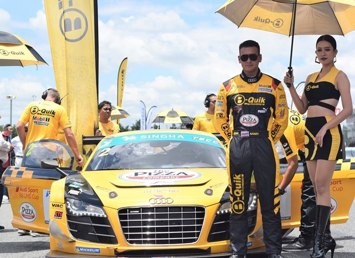 Thai driver Sandy Stuvik poses on the grid next to his B-Quik Racing Audi R8 GT3 Ultra at the Chang International Circuit in Buriram, Saturday, June 8.