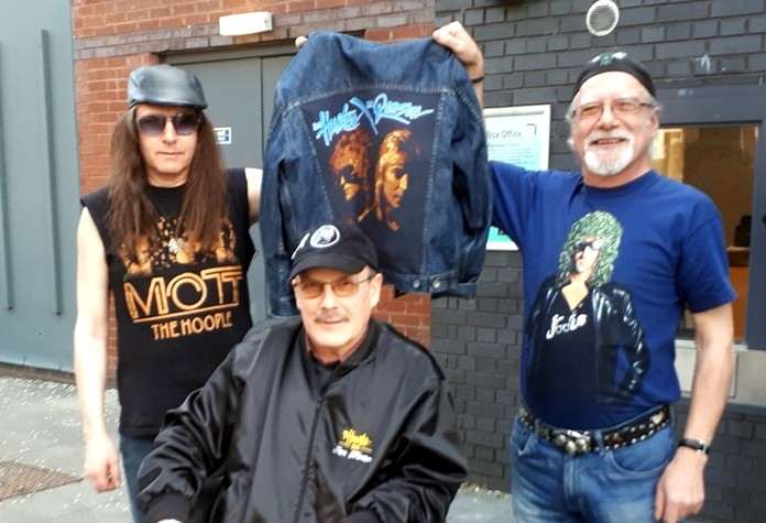Three Mott the Hoople fans outside the Beacon Theatre wear t-shirts individually designed and hand painted in Thailand.