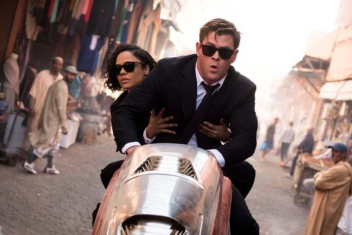 """This image shows Chris Hemsworth and Tessa Thompson in a scene from Columbia Pictures' """"Men in Black: International."""" (Giles Keyte/Sony/Columbia Pictures via AP)"""