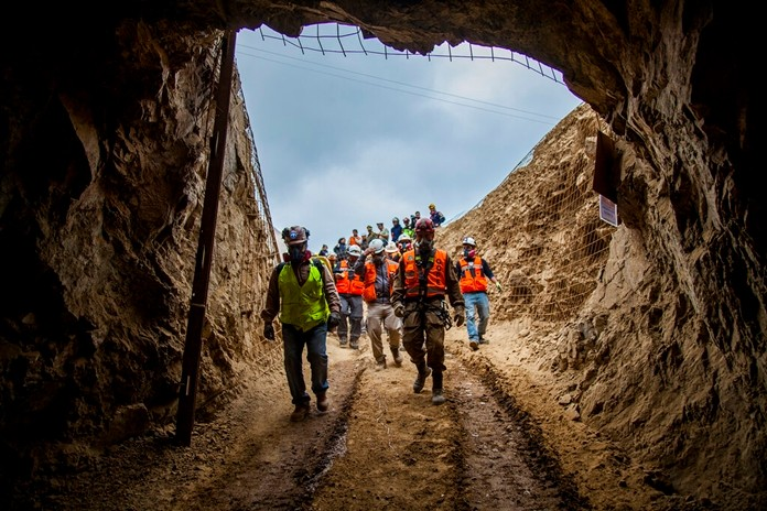 Men enter the San José mine to work on the rescue of three Bolivian miners trapped deep underground since the night before when it collapsed in Tocopilla, Chile, Friday, June 14, 2019. Local authorities confirmed that the men are alive. (Ricardo Rodriguez/Intendencia de Antofagasta via AP)