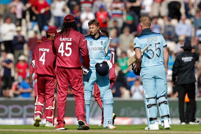 England's Joe Root, centre right, shakes hands with West Indies' Chris Gayle, at the end of the Cricket World Cup match between England and West Indies at the Hampshire Bowl in Southampton, England, Friday, June 14, 2019. England won by eight wickets. (AP Photo/Matt Dunham)