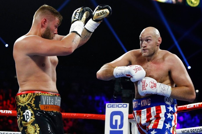 Tyson Fury, of England, right, and Tom Schwarz, of Germany, fight during their heavyweight boxing match Saturday, June 15, 2019, in Las Vegas. (AP Photo/John Locher)