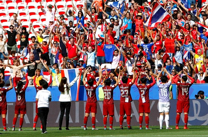 Thailand's players celebrate in front of their supporters after the Women's World Cup Group F soccer match between Sweden and Thailand at the Stade de Nice in Nice, France, Sunday, June 16, 2019. (AP Photo/Claude Paris)